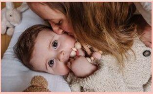 Fotografia Mustela mamá e hijo.